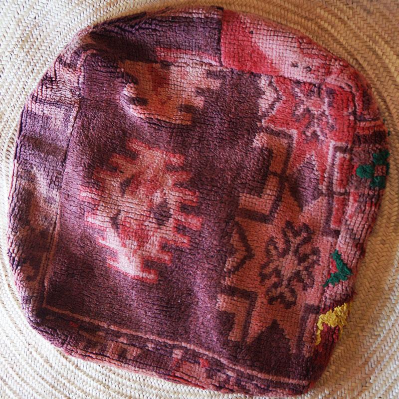 Moroccan vintage rug pouf.